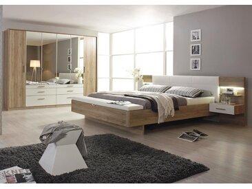 4-tlg. Schlafzimmer in Eiche Sanremo, Abs. alpinweiß, Drehtürenschrank B: 271 cm, Bettanlage B: 285 cm, inkl. 2 bel. Paneel-Nachtschränke, Polsterbank