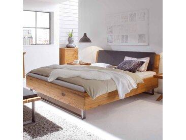 Bett aus Wildeiche Massivholz mit gepolstertem Kopfteil