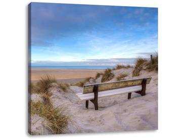 LeinwandbildBank in den Dünen mit Blick auf das Meer