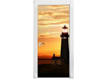 Türaufkleber Großer Leuchtturm im Sonnenuntergang