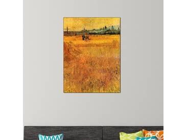 Wandbild Weizenfeld mit Blick auf Arles von Vincent van Gogh