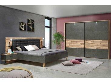Schlafzimmer in Stabeiche-Dekor und Betonoptik Grau, bestehend aus Bettanlage mit 2 Nachtkommoden, Schwebetürenschrank. Liegefläche 180 x 200 cm