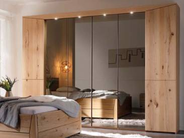 Thielemeyer Pura Drehtürenschrank in Front und Korpus aus Massivholz Naturbuche optional mit Beleuchtung