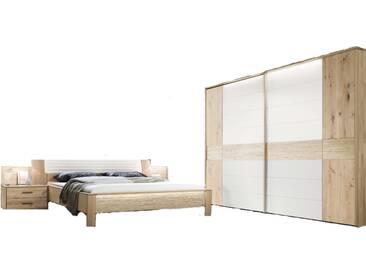Thielemeyer Mira 4.0 Schlafzimmer 2-teilig Korpus- und  Frontausführung Wildeiche Massivholz Komfortbett mit Kunstleder-Bogenkopfteil in weiß Liegefläche wählbar mit 2-türigem Schwebetürenschrank mit Colorglas in weiß mittig optional mit Konsolen mit Aufsatzpaneel und LED-Kranz-Beleuchtung