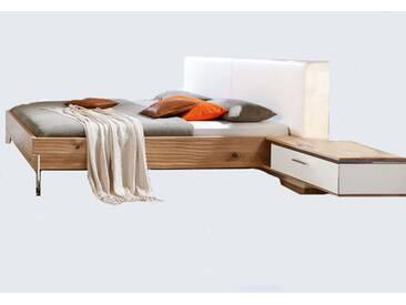 Thielemeyer Loft Komfort-Liegenbett mit Polsterkopfteil in Echtleder weiß Korpus Eiche Massivholz Liegefläche wählbar optional mit Hängekonsolen rechts und links mit weißem Colorglas mit oder ohne Vollauszug